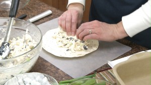 adding the filling to tortillas