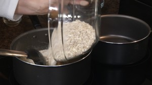 pouring oats into mixture