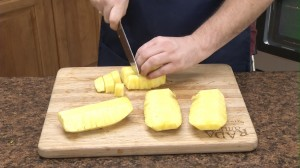 chopping the pineapple into large dice