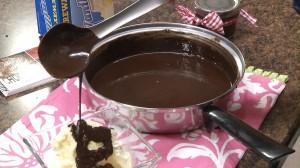 Fudge poured onto vanilla ice cream