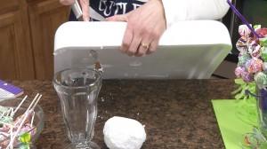 Using the Rada Cutlery Bagel Knife to cut foam that will be used in the lollipop malt bouquet.