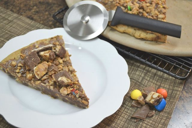A delicious candy bar pizza and a Rada Cutlery Pizza Cutter.