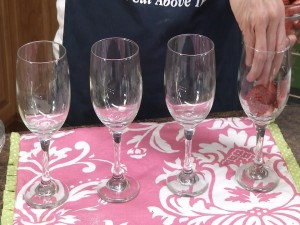 Kristy arranges wine glasses
