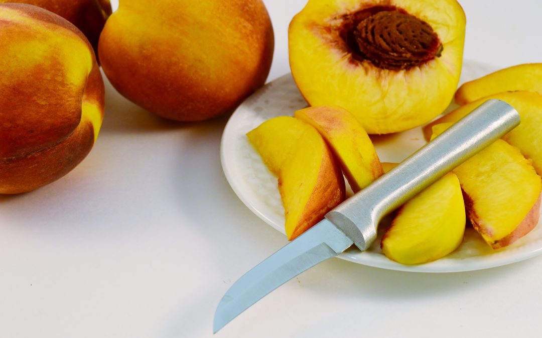A plate of lovely peaches with a Rada Granny Paring knife.