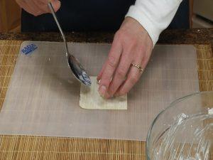 Preparing wonton for crab meat rangoons