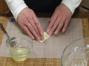 preparing crab rangoons