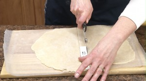 Cutting pie crust dough