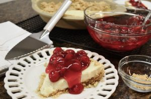 A delicious cherry cheesecake with a Rada Serrated Pie Server.