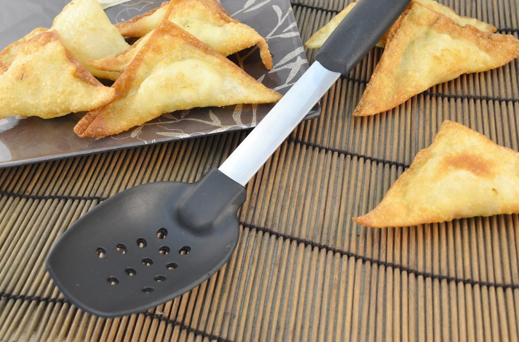 Delicious crab rangoons and a Rada Non-Scratch Spoon with Holes.