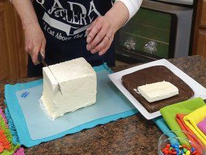 Cutting block of vanilla ice cream