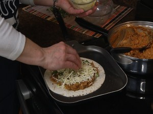 Adding cheese to quesadilla