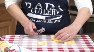 Slicing cheese with Rada Cheese Knife
