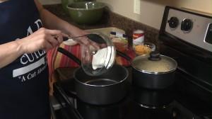 Adding cream cheese to saucepan