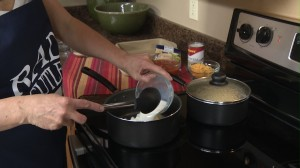 Adding milk to saucepan