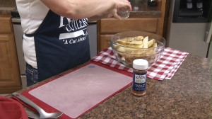 Pouring vegetable oil on wedges