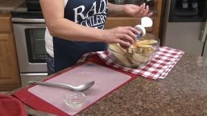 Seasoning potatoes with Rada Burger & Fry Seasoning
