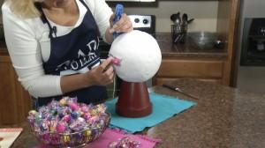 Placing gumballs on Styrofoam ball