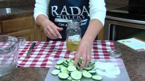 Placing pickles in jar