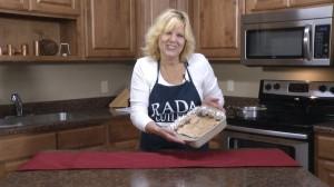 Kristy with finished Chocolate Cashew Macadamia Crunch