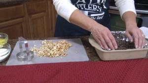 Placing nuts in pan