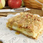 Apple Streusel Cheesecake Bars are absolutely delicious! This one is pictured with a Rada Vegetable Peeler.