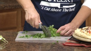 Kristy slicing cilantro.