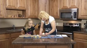 Kristy and Maya with crescent roll dough