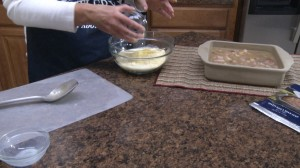 Adding egg and muffin mix.