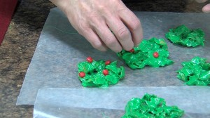 Adding cinnamon holly to wreaths