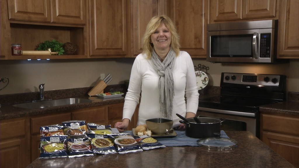 Kristi poses with an array of Rada Cutlery's tasty Quick Mixes.
