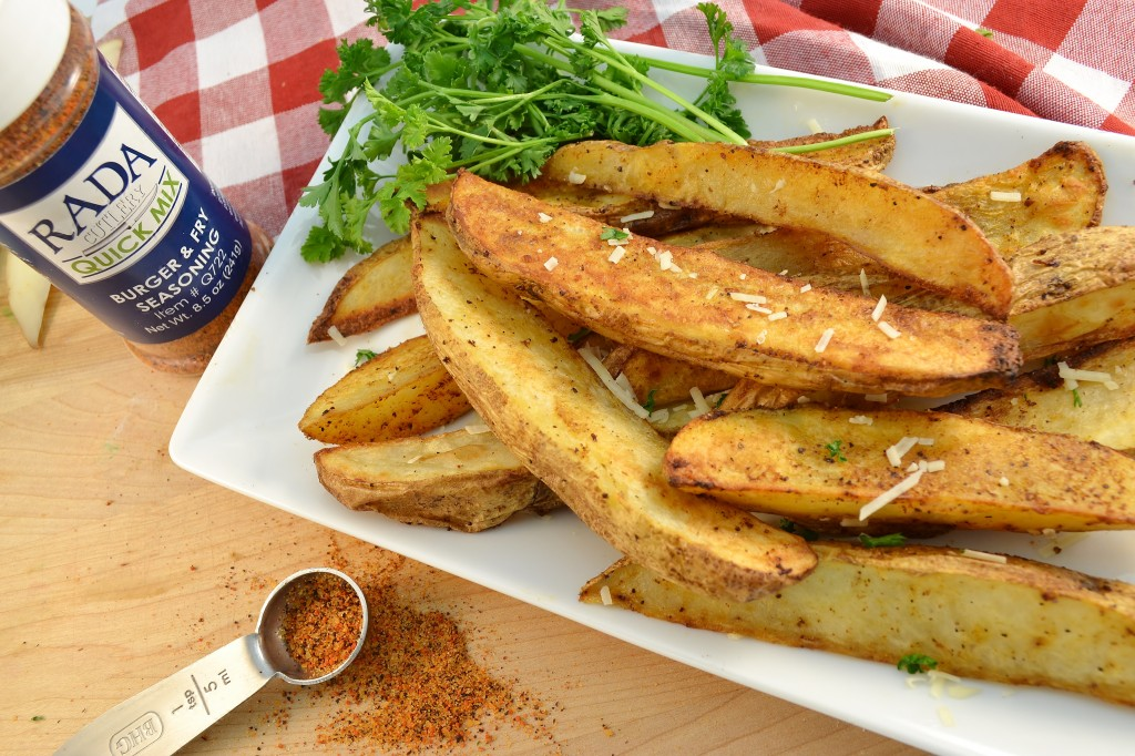 A plate of delicious potato wedges with Rada Cutlery seasoning.