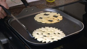 Frying tortillas in pan.