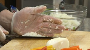 Adding onion to stuffing mixture