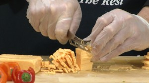 Slicing cheddar cheese with Rada Cheese Knife