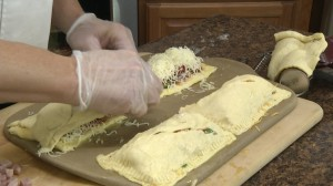 Adding cheese to calzones