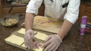 Adding ham to croissant