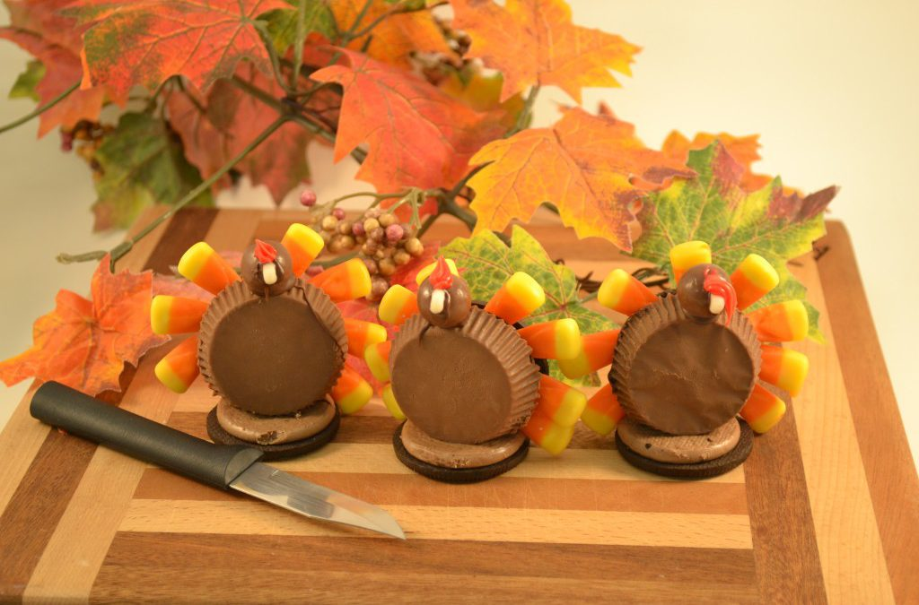 A trio of delicious chocolate turkey treats alongside a Rada Granny Paring knife.
