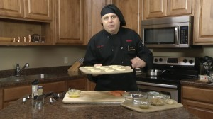 Chef Ted preparing to place pastry in oven.