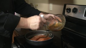 Adding glaze to salmon fillets.