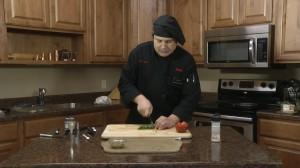 Chopping basil for pesto.