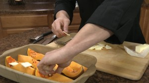 Placing butter on squash