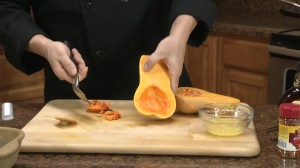 Scooping out squash seeds