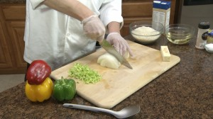 Chef Ted cutting onion for risotto.