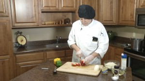 Chef Ted slicing a red pepper.
