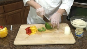 Chef Ted slicing a green pepper.