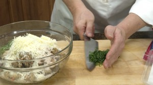 Adding basil leaves