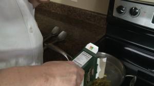 Adding tri-color rotini to water