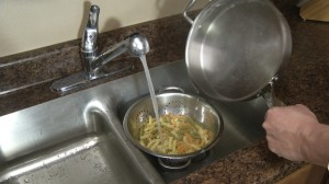Dousing pasta with cold water