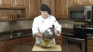 Adding pasta to pesto bowl
