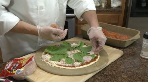 Adding Canadian bacon to pizza